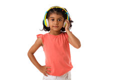 Music and technology concept.Child with headphones.Isolated. Music and technology concept.Child with headphones on white background Stock Photography