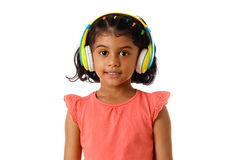 Music and technology concept.Child with headphones.Isolated. Music and technology concept.Child with headphones on white background Royalty Free Stock Photos