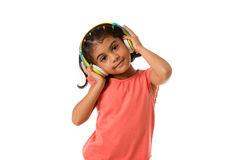 Music and technology concept.Child with headphones.Isolated. Music and technology concept.Child with headphones on white background Stock Image