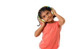 Music and technology concept.Child with headphones.Isolated. Music and technology concept.Child with headphones on white background.Copyspace Royalty Free Stock Photo