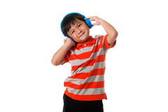 Music and technology concept.Little boy with headphones.Isolated. Music and technology concept.Asian little boy with headphones on white background Royalty Free Stock Image