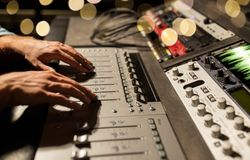 Man using mixing console in music recording studio stock photography
