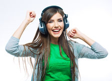 Music teenager girl dancing against isolated white background Stock Photo