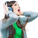 Music teenager girl dancing against white.  backgr Royalty Free Stock Photo