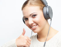 Music teenager girl dancing against white background. Woman with headphones listening music. Music teenager girl dancing against white background Royalty Free Stock Images