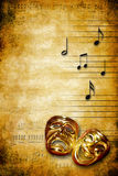 Music and theatre. Theatrical mask of tragedy and comedy on a grunge music sheet with notes Stock Photo