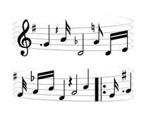 Music theme. Black music on the white background Stock Photos