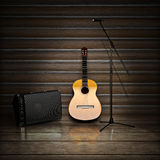 Music themed background with acoustic guitar , amp and microphone. Stock Photo