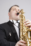 Music Themes and Ideas. One Caucasian Male Saxophonist Playing Saxophone Royalty Free Stock Image