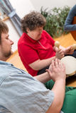 Music therapy with a mentally disabled woman Stock Photos