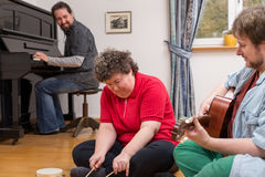 Music therapy with a mentally disabled woman Stock Photography