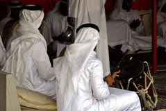 Music time. Several people in Islamic garb playing music Stock Images