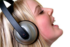 Music Time. Female listening to music on headphones Royalty Free Stock Photo