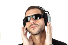 Music time. Middle age man with sunglasses listening to music. Head portrait Stock Images