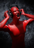 Music to blow your mind. 3D render of male figure listening to painfully loud music through headphones Royalty Free Stock Photography