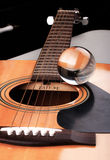 Music to My Eyes. Closeup of an acoustic guitar with a glass ball set atop the sound board next to the sound hole Royalty Free Stock Photos