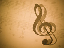 Music and treble clef Stock Photography