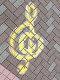Music treble clef. On the pavement of ceramic tiles Stock Images