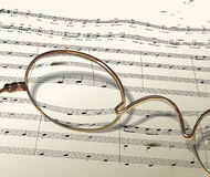 Music (Vector). Sheet music seen through a pair of glasses Stock Images