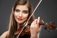 Music violin. Female face close up. Stock Photos