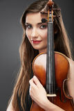 Music violin. Female face close up Royalty Free Stock Photos