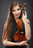 Music violin. Female face close up. Royalty Free Stock Image