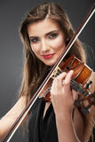 Music violin. Female face close up. Royalty Free Stock Images