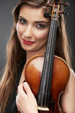 Music violin. Female face close up Royalty Free Stock Image