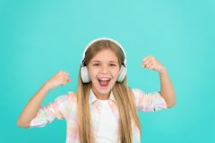 On the music waves. Adorable music fan. Music makes her happy. Little girl child listening to music. Happy little child royalty free stock photo