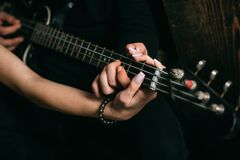 On the music waves. Couple in love play duets. Couple of musicians enjoy playing music. Male and female hands play the. Electric guitar. Couple of guitar royalty free stock photography