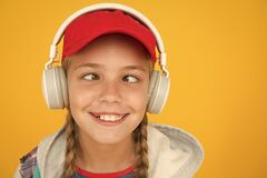 Free Music With Emotions. Squint-eyed Kid On Yellow Background. Funny Child Listen To Music In Stereo Headphones. Small Child Stock Image - 173539351