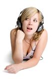 Music Woman. Beautiful woman listening to music royalty free stock photo