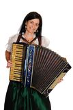 Music. Woman in bavarian dirndl with accordion in front of a white background Royalty Free Stock Image