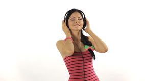 Music. Woman dancing with  headphones listening to Royalty Free Stock Image
