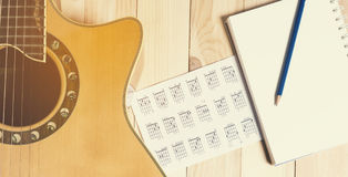 Music writing equipment on wooden table Royalty Free Stock Photos