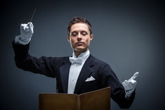 Music. Young conductor in a tuxedo Royalty Free Stock Image