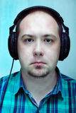 Music. The young man listens to music in headphones royalty free stock photography