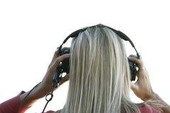 Musica d'ascolto con le cuffie Fotografie Stock Libere da Diritti