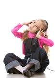 Musica d'ascolto della bambina Fotografia Stock Libera da Diritti