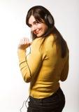 Musica d'ascolto della donna Immagini Stock Libere da Diritti