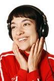 Musica d'ascolto della donna Fotografie Stock Libere da Diritti