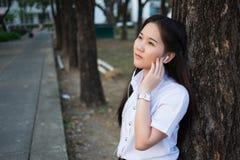 Musica d'ascolto della donna asiatica Immagine Stock Libera da Diritti