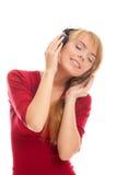 Musica distesa e d'ascolto dell'adolescente Immagini Stock Libere da Diritti