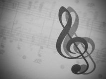 Musica e clef triplo Fotografie Stock Libere da Diritti