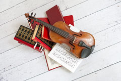 Musical art. Picture of a violin on a stack of books Stock Photo