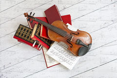 Musical art. Picture of a violin on a stack of books Stock Images