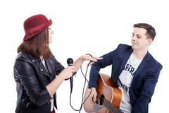 Musical artists sing and play acoustic guitar. Royalty Free Stock Photo