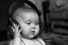 Musical-baby. An image of girl listening to music Royalty Free Stock Photos