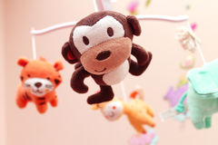 A musical baby carousel toy. A musical carousel toy for babies with some soft stuffed toy animals. This carousel is usually put on the baby cribs Royalty Free Stock Images