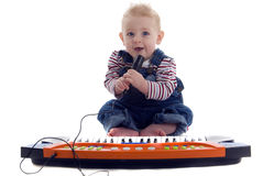 Musical baby plays the keyboard and sings karoke Royalty Free Stock Image